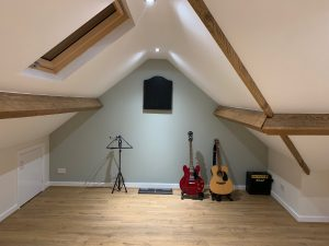 Guitars in Loft space in Huby, Leeds, West Yorkshire