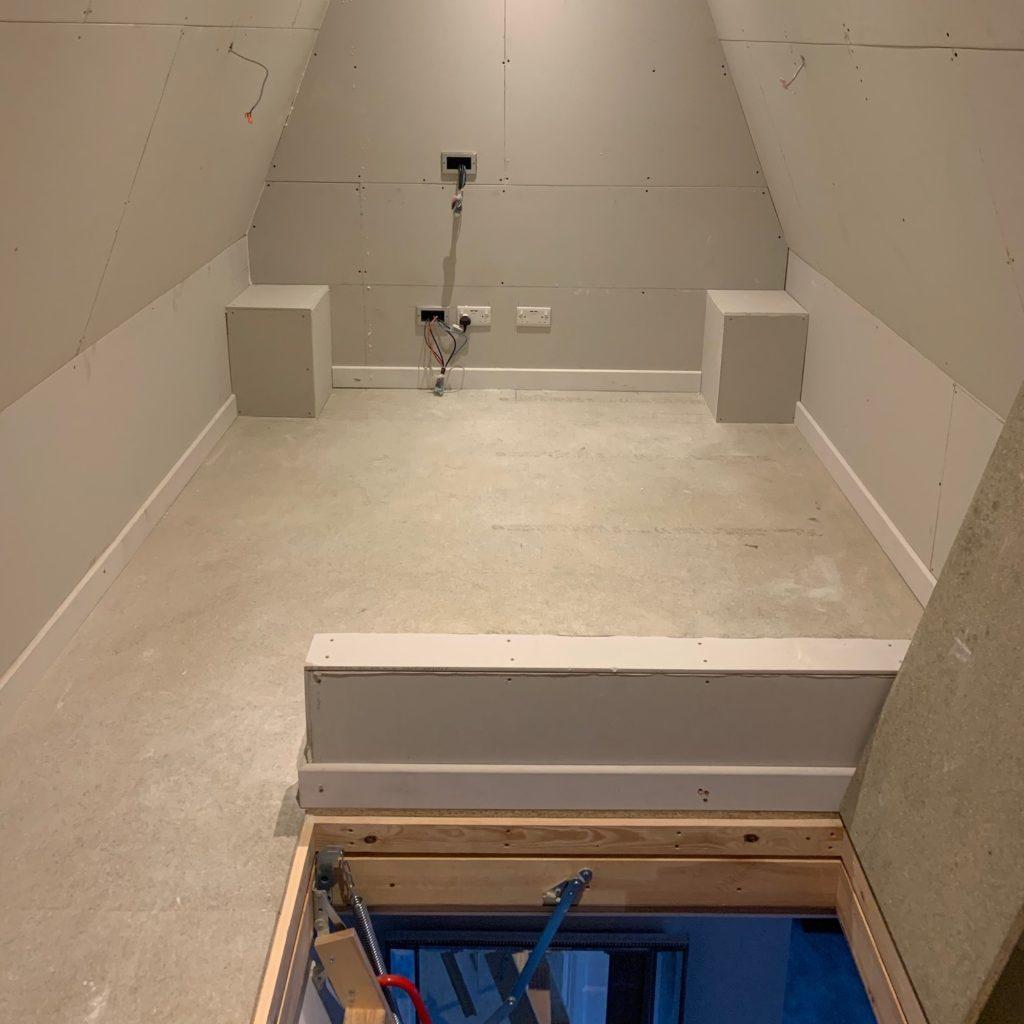 Wall ready for TV install in mini cinema in loft