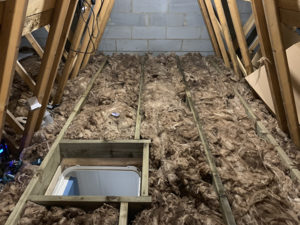 Insulation re-laid neatly between joists