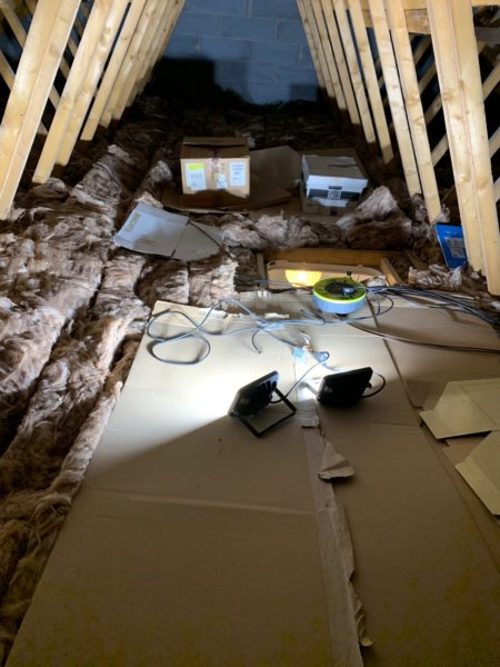 boxes sat on current loft floor squashing down the insulation